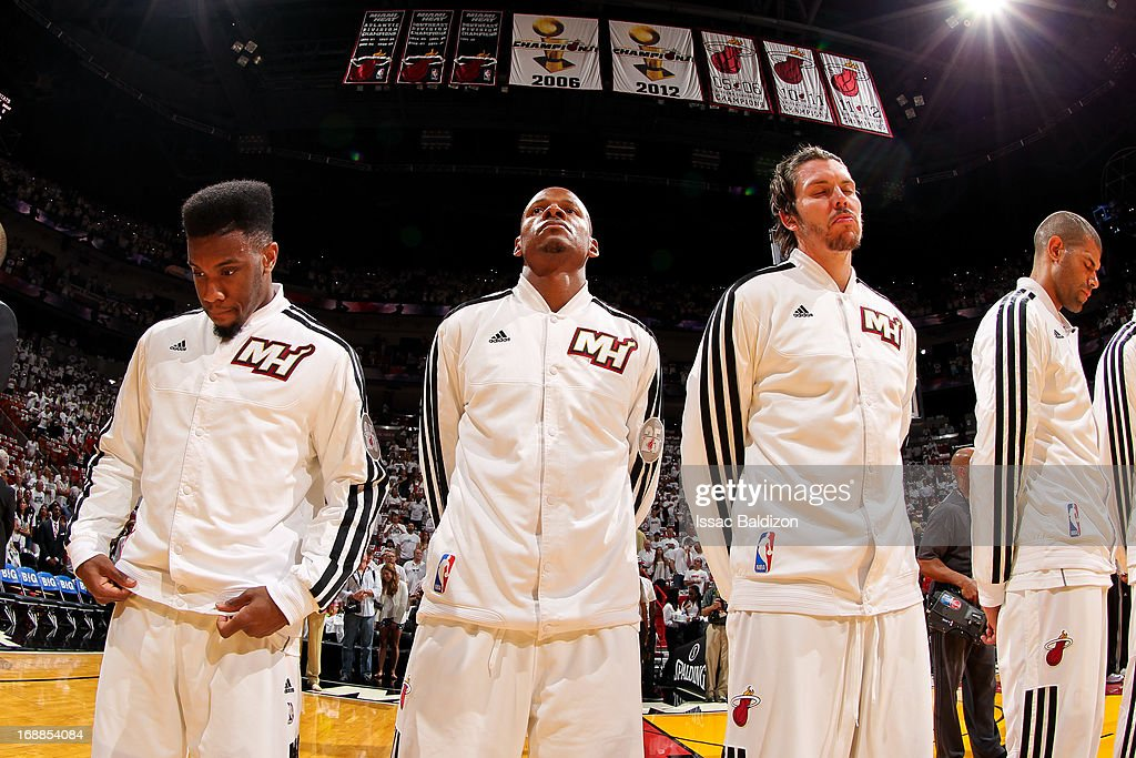 Miami Heat players, from left, Norris Cole #30, Ray Allen #34 and Mike Miller #13, standing under the team's Championship banners, listen to the National Anthem before playing against the Miami Heat in Game Five of the Eastern Conference Semifinals during the 2013 NBA Playoffs on May 15, 2013 at American Airlines Arena in Miami, Florida.