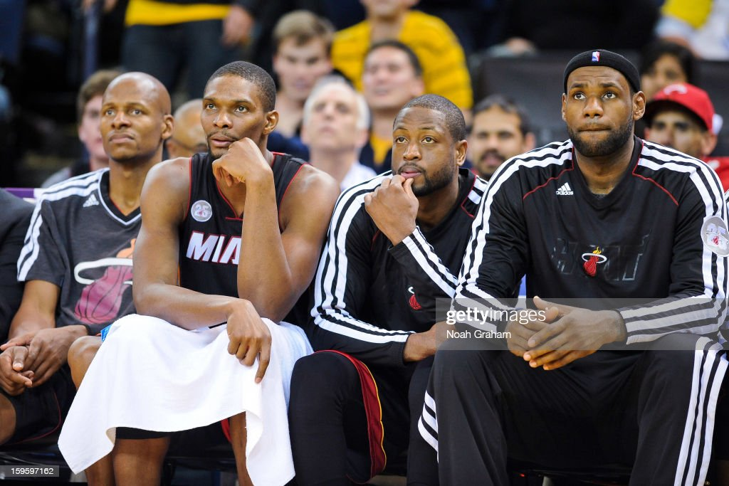 Miami Heat players, from left, Ray Allen #34, Chris Bosh #1, Dwyane Wade #3 and LeBron James #6 look on from the bench during a game against the Golden State Warriors on January 16, 2013 at Oracle Arena in Oakland, California.