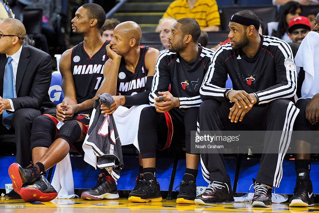 Miami Heat players, from right, LeBron James #6, Dwyane Wade #3, Ray Allen #34 and Chris Bosh #1 look on from the bench during a game against the Golden State Warriors on January 16, 2013 at Oracle Arena in Oakland, California.