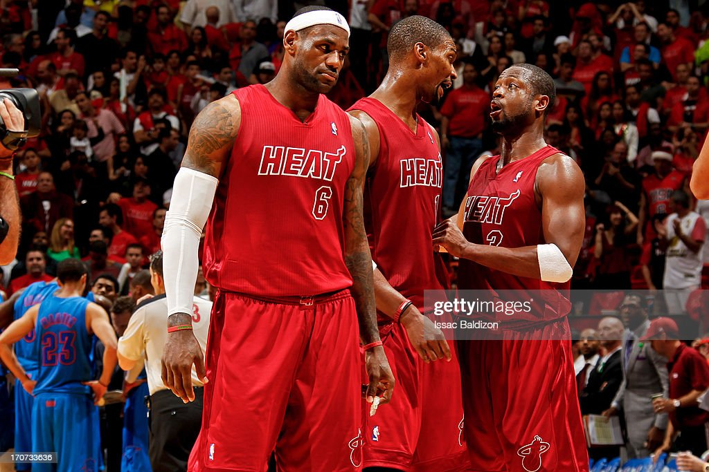 Miami Heat players LeBron James #6, Chris Bosh #1 and Dwyane Wade #3 wait to resume play against the Oklahoma City Thunder during a Christmas Day game on December 25, 2012 at American Airlines Arena in Miami, Florida.