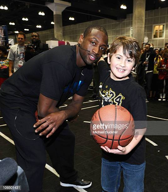 Miami Heat Point Guard Dwyane Wade greets fans at TMobile NBA on 4G Interactive Space at Jam Session during NBA AllStar 2011 on February 19 2011 in...