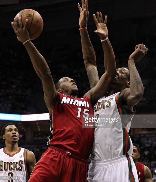 Miami Heat point guard Mario Chalmers drives to the basket against Milwaukee Bucks center Larry Sanders during firstquarter action in Game 4 of the...
