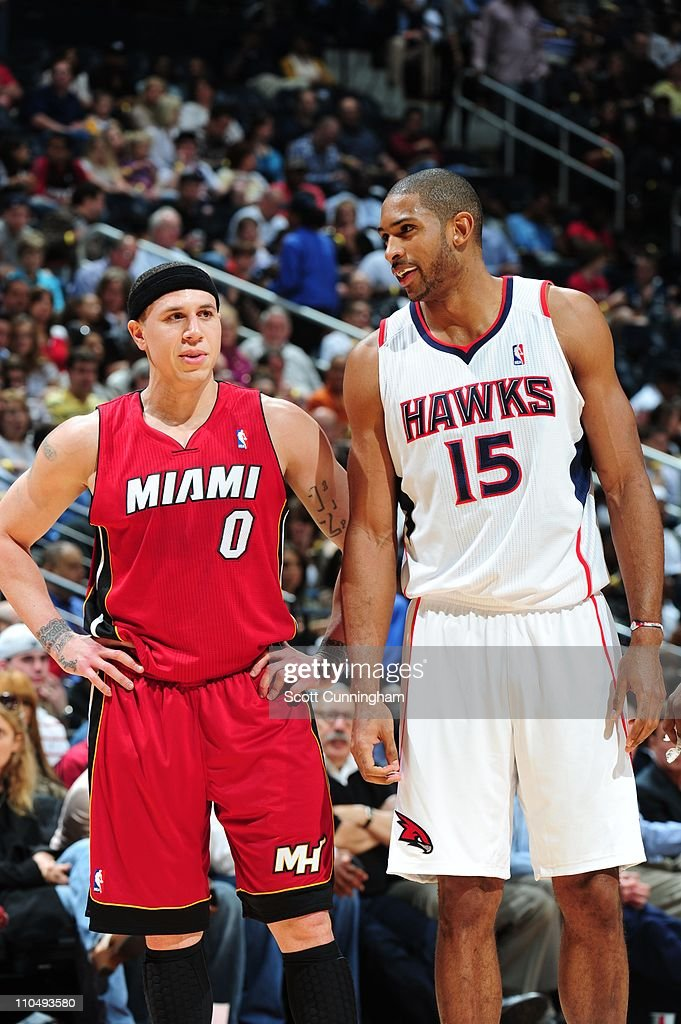 Miami Heat point guard Mike Bibby and Atlanta Hawks center Al Horford look on during the game against the Atlanta Hawks on March 18 2011 at Philips...