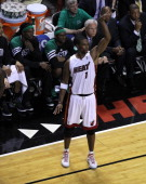 Miami Heat power forward Chris Bosh holds his form after he stuck a three pointer directly in front of the Boston Celtics bench during the fourth...
