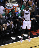 Miami Heat power forward Chris Bosh sticks a three pointer directly in front of the Boston Celtics bench during the fourth quarter Boston Celtics NBA...