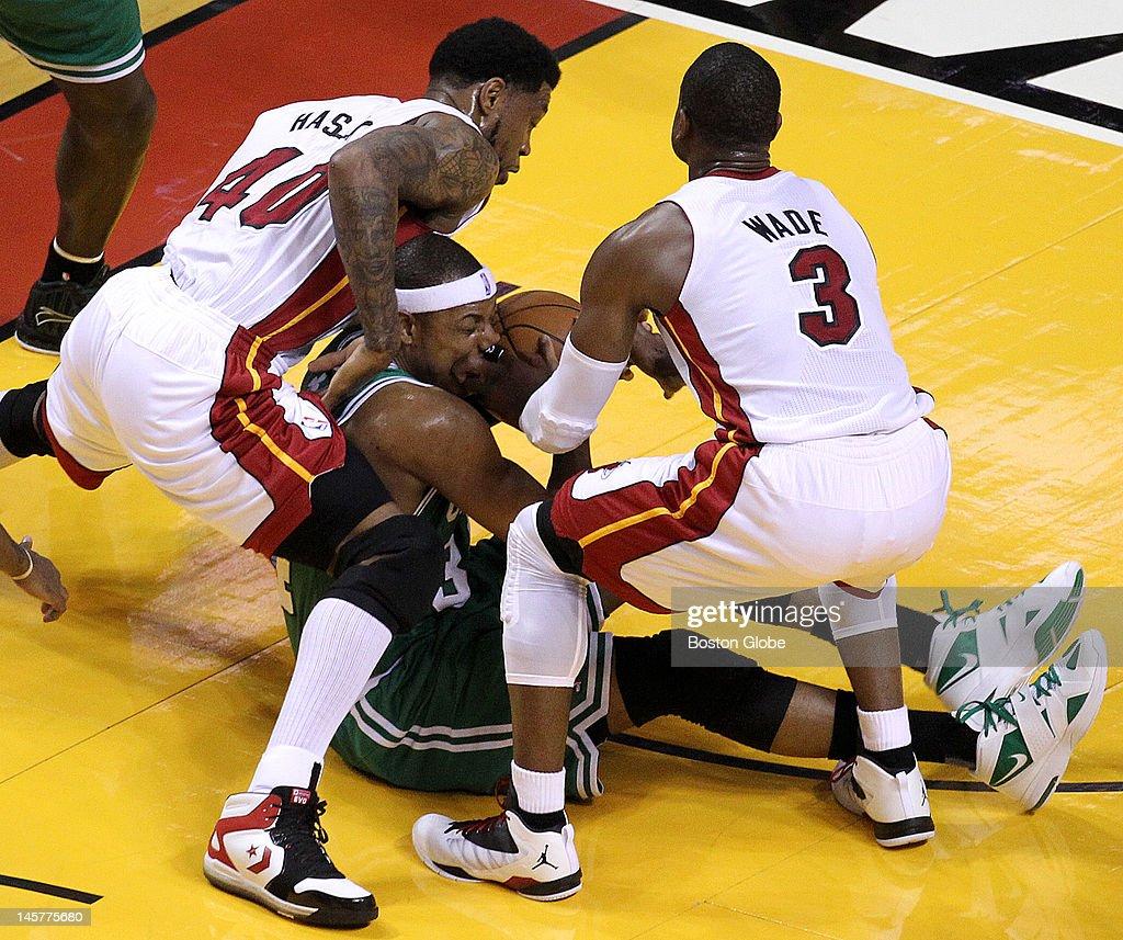 Miami Heat power forward Udonis Haslem and Miami Heat shooting guard Dwyane Wade double down on Boston Celtics small forward Paul Pierce who battles...