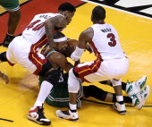 Miami Heat power forward Udonis Haslem and Miami Heat shooting guard Dwyane Wade double down on Boston Celtics small forward Paul Pierce who battles...