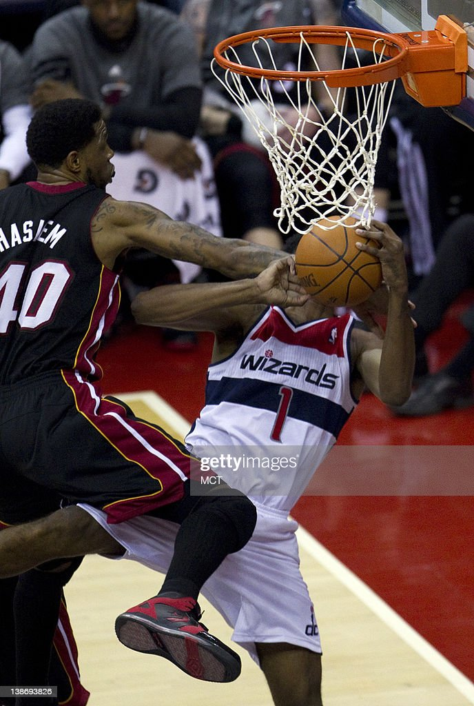 Miami Heat power forward Udonis Haslem (40) defends against Washington Wizards shooting guard Nick Young (1) during fourth-quarter action at the Verizon Center in Washington, D.C., Friday, February 10, 2012. The Heat defeated the Wizard, 106-89.