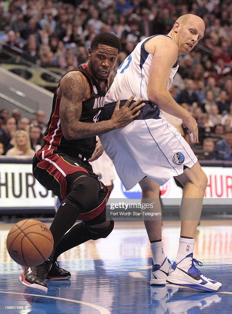Miami Heat power forward Udonis Haslem, left, and Dallas Mavericks center Chris Kaman look to a loose ball during an NBA game at the American Airlines Center on Thursday, December 20, 2012, in Dallas, Texas.