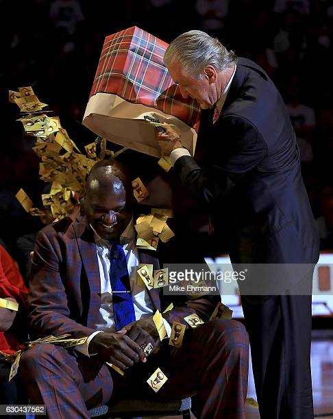 Miami Heat president Pat Riley speaks during a ceremony to honor Shaquille O'Neal as he has his number retired during a game between the Miami Heat...