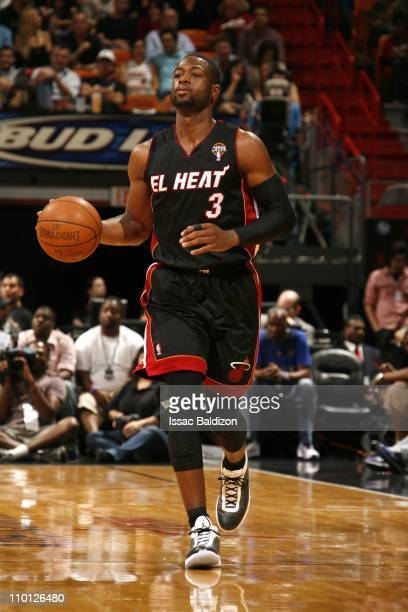 Miami Heat shooting guard Dwyane Wade brings the ball up court during the game against the San Antonio Spurs on March 14 2011 at American Airlines...