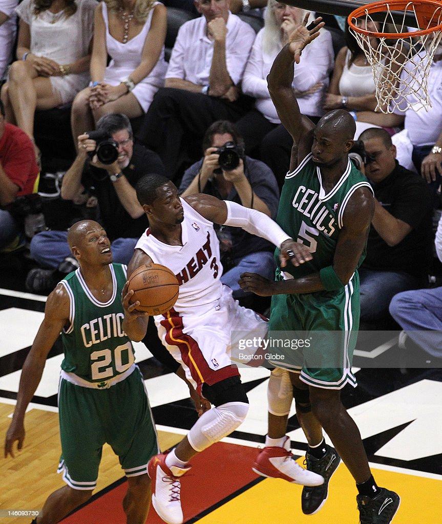 Miami Heat shooting guard Dwyane Wade looks to pass after finding his path blocked by Boston Celtics power forward Kevin Garnett Boston Celtics NBA...