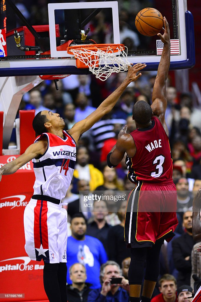 Miami Heat shooting guard Dwyane Wade (3) shoots against Washington Wizards point guard Shaun Livingston (14) in the fourth quarter at the Verizon Center in Washington, D.C., Tuesday, December 4, 2012. The Wizards defeated the Miami, 105-101.
