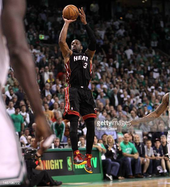 Miami Heat shooting guard Dwyane Wade takes a last second attempt to win the game from the three point line but missed his mark giving the Celtics...