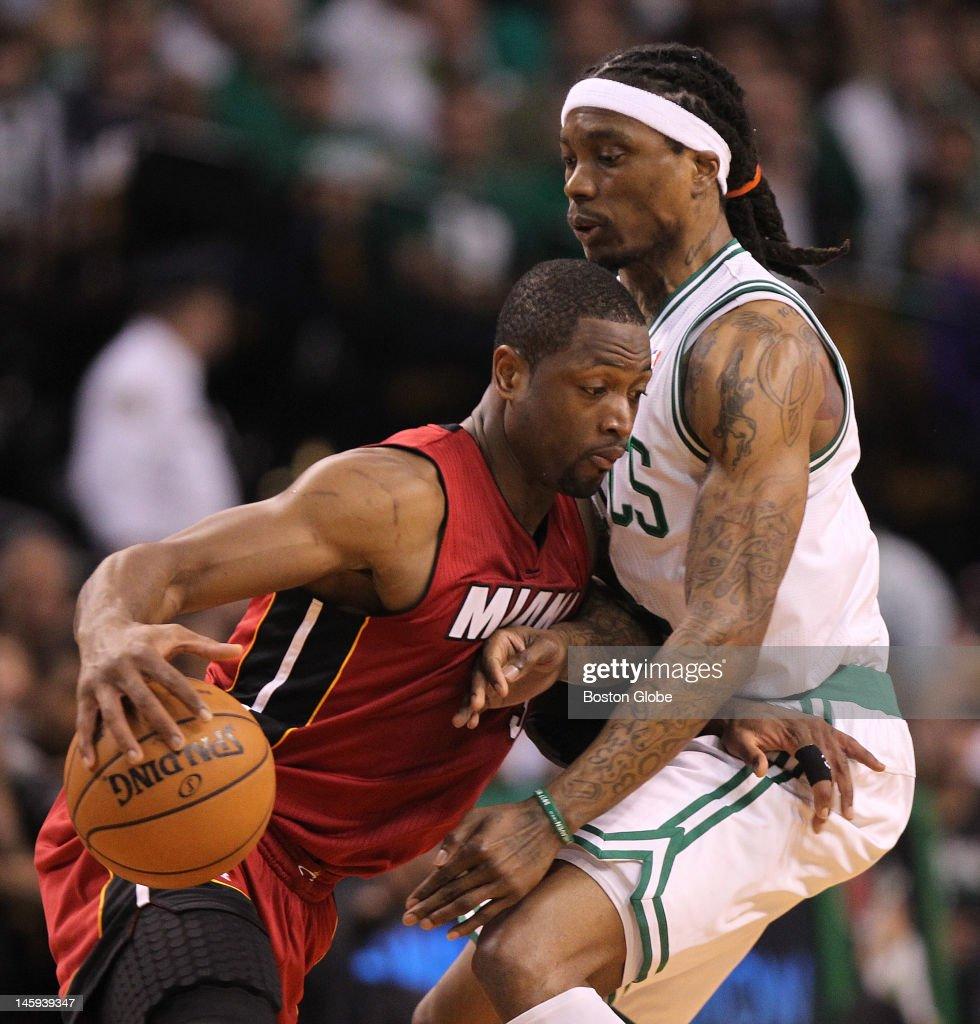 Miami Heat shooting guard Dwyane Wade tries to get past Boston Celtics shooting guard Marquis Daniels in the first quarter Boston Celtics NBA...
