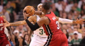 Miami Heat shooting guard Dwyane Wade tyres to get pass around Boston Celtics small forward Paul Pierce in the first quarter Boston Celtics NBA...