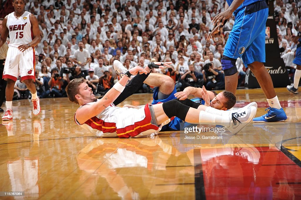 Miami Heat shooting guard <a gi-track='captionPersonalityLinkClicked' href=/galleries/search?phrase=Mike+Miller+-+Joueur+de+basketball&family=editorial&specificpeople=201801 ng-click='$event.stopPropagation()'>Mike Miller</a> #13 and Dallas Mavericks point guard Jose Juan Barea #11 collapse during the play against the Dallas Mavericks during Game Two of the 2011 NBA Finals on June 02, 2011 at the American Airlines Arena in Miami, Florida. The Mavericks won 95-93.NOTE