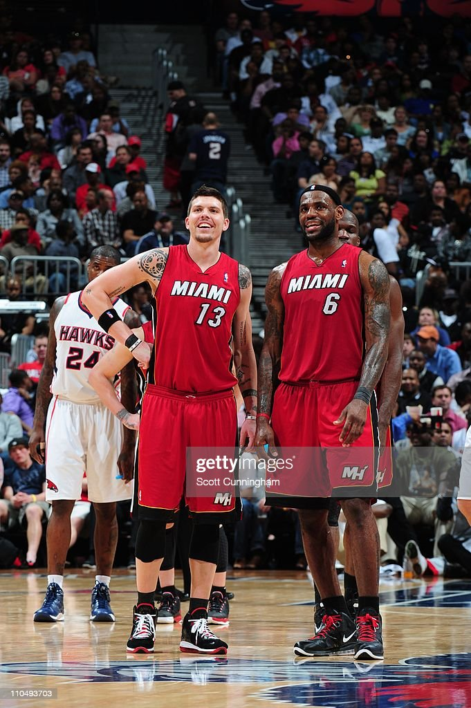 Miami Heat shooting guard <a gi-track='captionPersonalityLinkClicked' href=/galleries/search?phrase=Mike+Miller+-+Joueur+de+basketball&family=editorial&specificpeople=201801 ng-click='$event.stopPropagation()'>Mike Miller</a> #13 and Miami Heat small forward <a gi-track='captionPersonalityLinkClicked' href=/galleries/search?phrase=LeBron+James&family=editorial&specificpeople=201474 ng-click='$event.stopPropagation()'>LeBron James</a> #6 smile during the game against the Atlanta Hawks on March 18, 2011 at Philips Arena in Atlanta, Georgia. The Heat won 106-85.