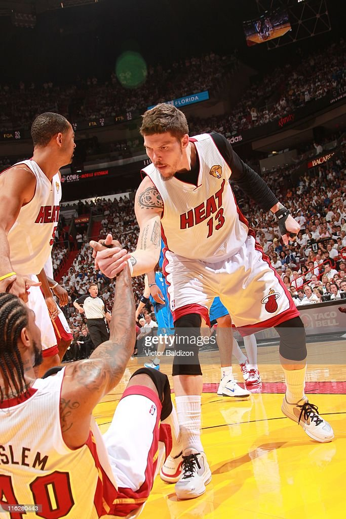 Miami Heat shooting guard <a gi-track='captionPersonalityLinkClicked' href=/galleries/search?phrase=Mike+Miller+-+Basketball+Player&family=editorial&specificpeople=201801 ng-click='$event.stopPropagation()'>Mike Miller</a> #13 helps Miami Heat power forward <a gi-track='captionPersonalityLinkClicked' href=/galleries/search?phrase=Udonis+Haslem&family=editorial&specificpeople=201748 ng-click='$event.stopPropagation()'>Udonis Haslem</a> #40 stand up as he is floored during Game Six of the 2011 NBA Finals between the Dallas Mavericks and the Miami Heat on June 12, 2011 at the American Airlines Arena in Miami, Florida. The Mavericks won 105-95.
