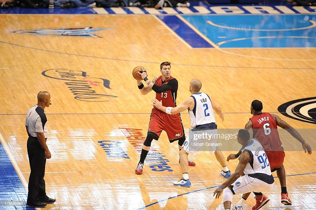 Miami Heat shooting guard <a gi-track='captionPersonalityLinkClicked' href=/galleries/search?phrase=Mike+Miller+-+Basketball+Player&family=editorial&specificpeople=201801 ng-click='$event.stopPropagation()'>Mike Miller</a> #13 protects the ball against Dallas Mavericks point guard <a gi-track='captionPersonalityLinkClicked' href=/galleries/search?phrase=Jason+Kidd&family=editorial&specificpeople=201560 ng-click='$event.stopPropagation()'>Jason Kidd</a> #2 during the play against the Dallas Mavericks in Game Four of the 2011 NBA Finals on June 7, 2011 at the American Airlines Center in Dallas, Texas.