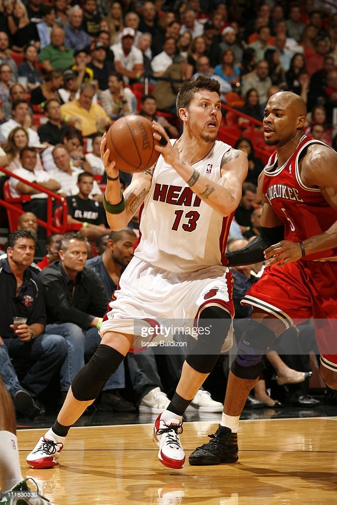 Miami Heat shooting guard <a gi-track='captionPersonalityLinkClicked' href=/galleries/search?phrase=Mike+Miller+-+Jugador+de+baloncesto&family=editorial&specificpeople=201801 ng-click='$event.stopPropagation()'>Mike Miller</a> #13 protects the ball during the game against the Milwaukee Bucks on April 6, 2011 at American Airlines Arena in Miami, Florida. The Bucks won 90-85.