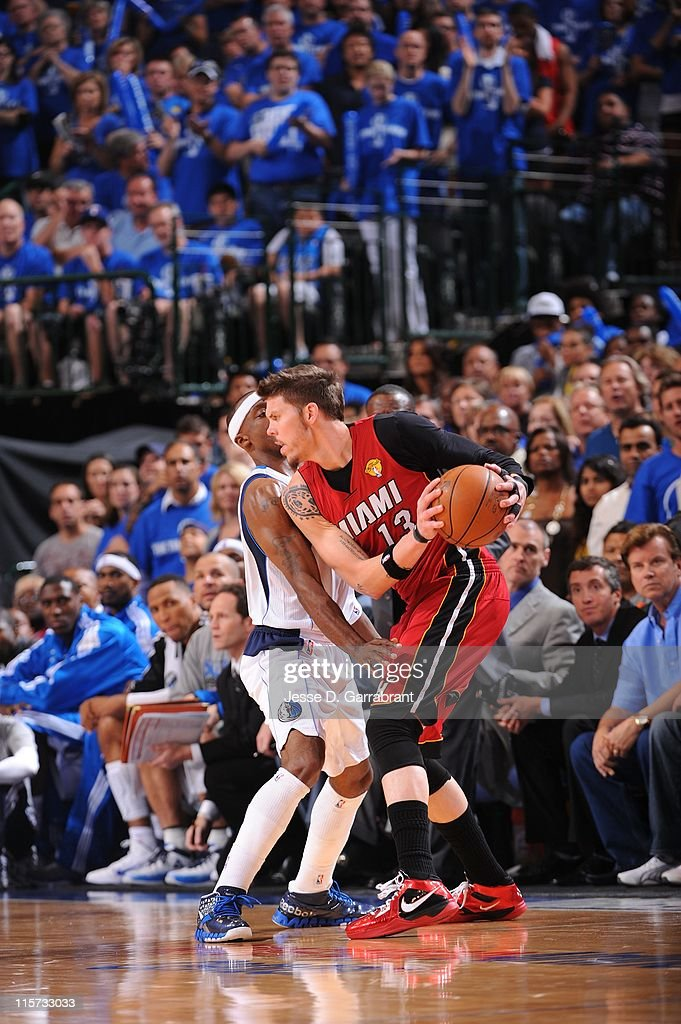 Miami Heat shooting guard <a gi-track='captionPersonalityLinkClicked' href=/galleries/search?phrase=Mike+Miller+-+Joueur+de+basketball&family=editorial&specificpeople=201801 ng-click='$event.stopPropagation()'>Mike Miller</a> #13 protects the ball during the play against the Dallas Mavericks during Game Four of the 2011 NBA Finals on June 7, 2011 at the American Airlines Center in Dallas, Texas. The Mavericks won 86-83.
