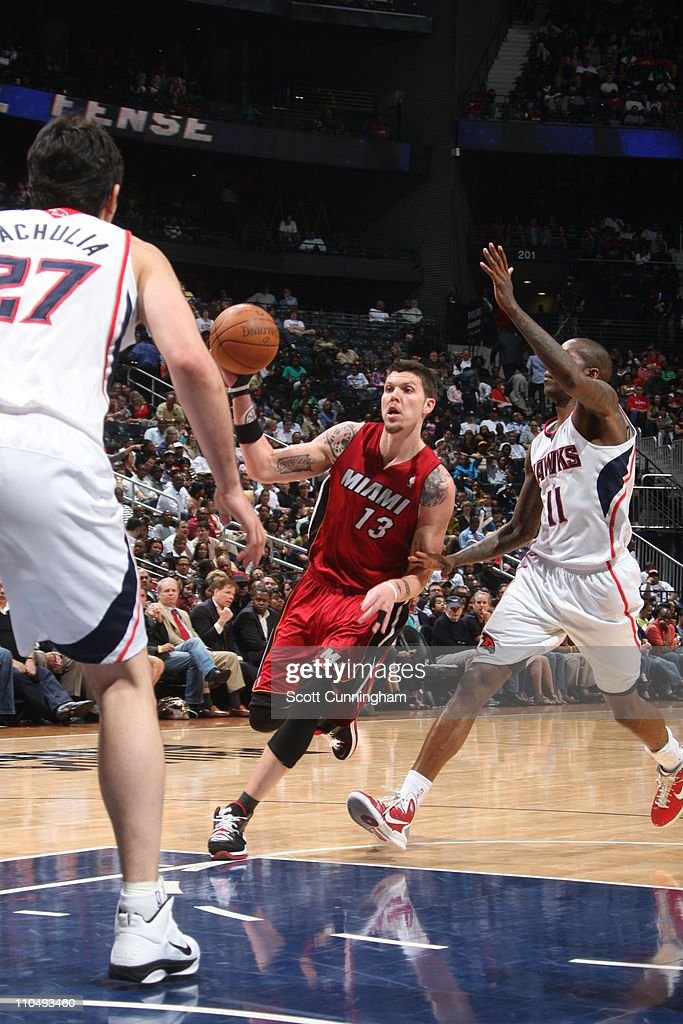 Miami Heat shooting guard Mike Miller splits defense during the game against the Atlanta Hawks on March 18 2011 at Philips Arena in Atlanta Georgia...