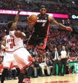 Miami Heat small forward LeBron James is fouled by Chicago Bulls small forward Jimmy Butler on his way to the basket during the first half in Game 4...