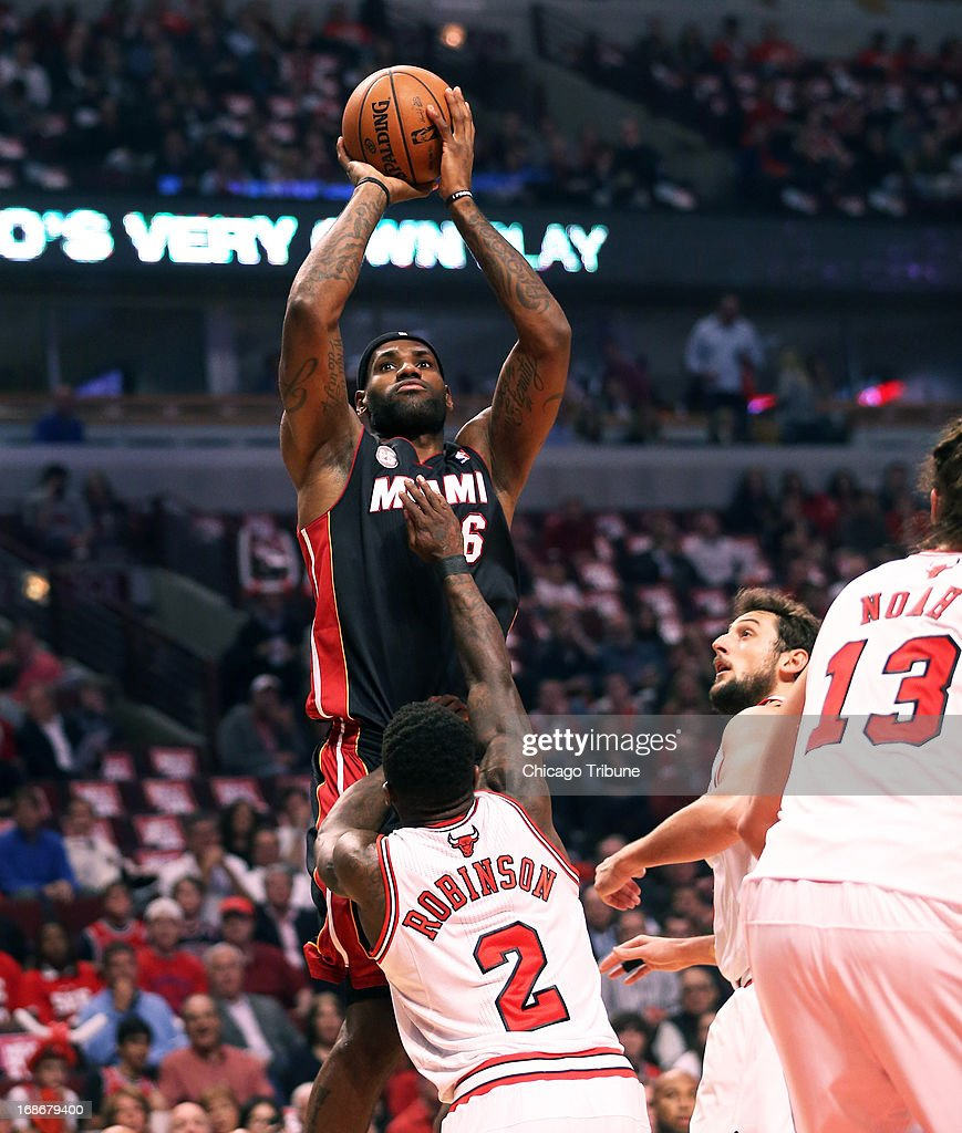 Miami Heat small forward LeBron James (6) makes a shot over Chicago Bulls point guard Nate Robinson (2) during the first half in Game 4 of the NBA Eastern Conference playoffs at the United Center in Chicago, Illinois, Monday May 13, 2013.