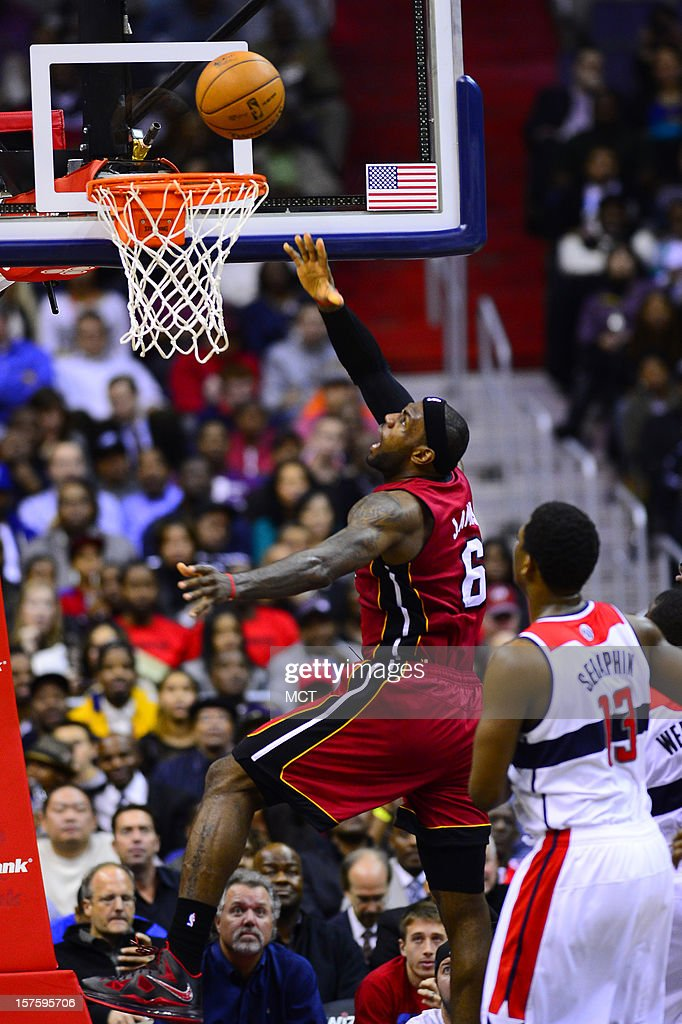Miami Heat small forward LeBron James (6) puts up a shot past Washington Wizards power forward Kevin Seraphin (13) in the fourth quarter at the Verizon Center in Washington, D.C., Tuesday, December 4, 2012.