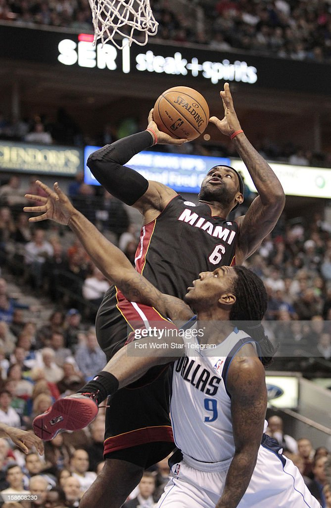 Miami Heat small forward LeBron James shoots over Dallas Mavericks small forward Jae Crowder during an NBA game at the American Airlines Center on Thursday, December 20, 2012, in Dallas, Texas.
