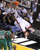 Miami Heat small forward LeBron James stayed around for some extra long hang time after this steal and dunk late in the second quarter Boston Celtics...