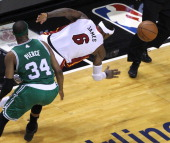 Miami Heat small forward LeBron James steals the ball from Boston Celtics small forward Paul Pierce enroute to a monster dunk late in the second...