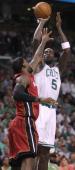 Miami Heat small forward LeBron James tries to block Boston Celtics power forward Kevin Garnett as he takes a shot in the first quarter Boston...
