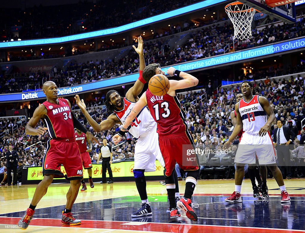 Miami Heat small forward Mike Miller (13) and Washington Wizards center Nene (42) battle for a rebound in the third quarter at the Verizon Center in Washington, D.C., Tuesday, December 4, 2012.