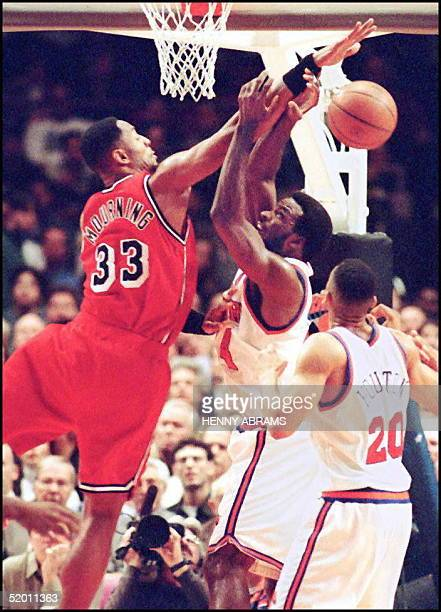 Miami Heat's Alonzo Mourning blocks a shot attempt by the New York Knicks' Charles Oakley while Knicks' Allan Houton looks on early in the second...