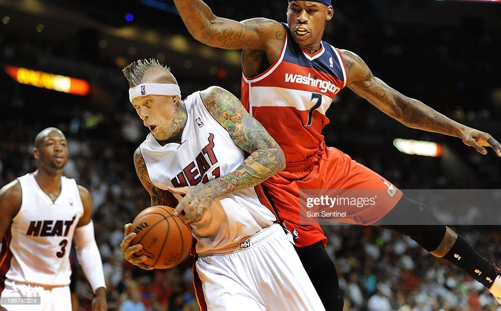 Miami Heat's Chris Andersen grabs a rebound against Washington Wizards' Al Harrington at the AmericanAirlines Arena in Miami, Florida, on Sunday, November 3, 2013.