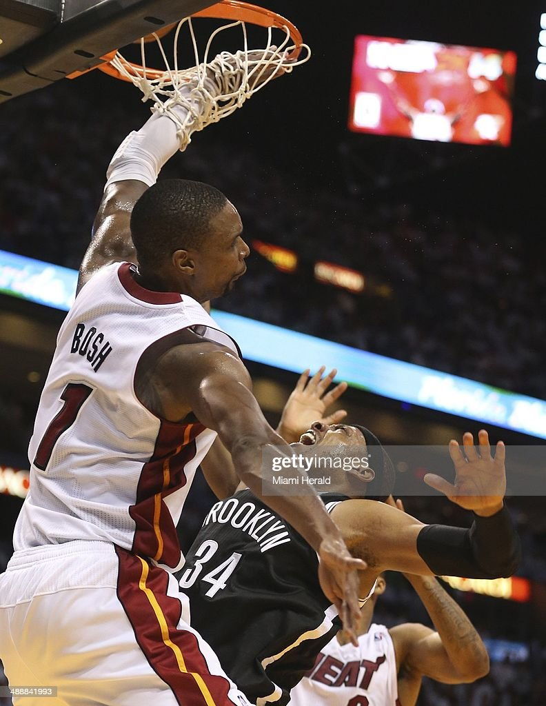 Miami Heat's Chris Bosh blocks Brooklyn Nets' Paul Pierce at the rim in the third quarter during Game 2 of Eastern Conference semifinals on Thursday, May 8, 2014, in Miami.