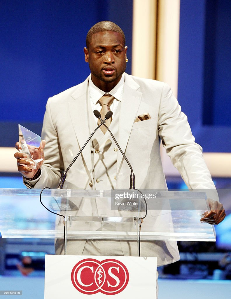Miami Heats' Dwyane Wade accepts an award onstage at the Cedars-Sinai Medical Center's 24th Annual Sports Spectacular at the Century Plaza Hotel on June 7, 2009 in Los Angeles, California.