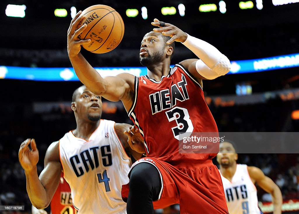 Miami Heat's Dwyane Wade drives to the basket against Charlotte Bobcats' Jeff Adrien during the first half at the AmericanAirlines Arena in Miami, Florida, Monday, February 4, 2013.