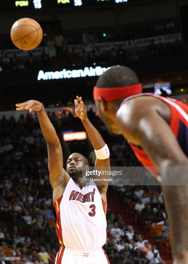 Miami Heat's Dwyane Wade shoots a free throw against the Atlanta Hawks during the first half at American Airlines Arena on Monday, December 10, 2012, in Miami, Florida.