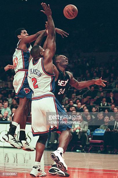 Miami Heat's Jamal Mashburn has his shot blocked by the New York Knicks' Kurt Thomas but gets fouled by the Knicks' Larry Johnson in the first...