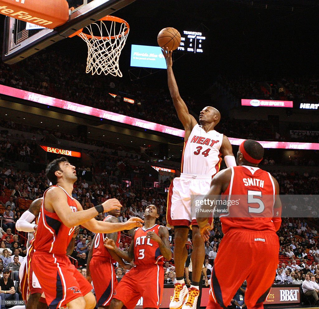 Miami Heat's Ray Allen scores a basket against Atlanta Hawks during the first half at American Airlines Arena on Monday, December 10, 2012, in Miami, Florida.