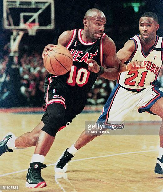 Miami Heat's Tim Hardaway drives to the basket on the New York Knicks' Charlie Ward in the first quarter of the fourth game of their first round...