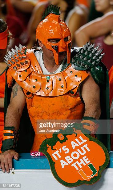 Miami Hurricanes fan in costume watches fourth quarter action against the Florida State Seminoles on October 8 2016 at Hard Rock Stadium in Miami...