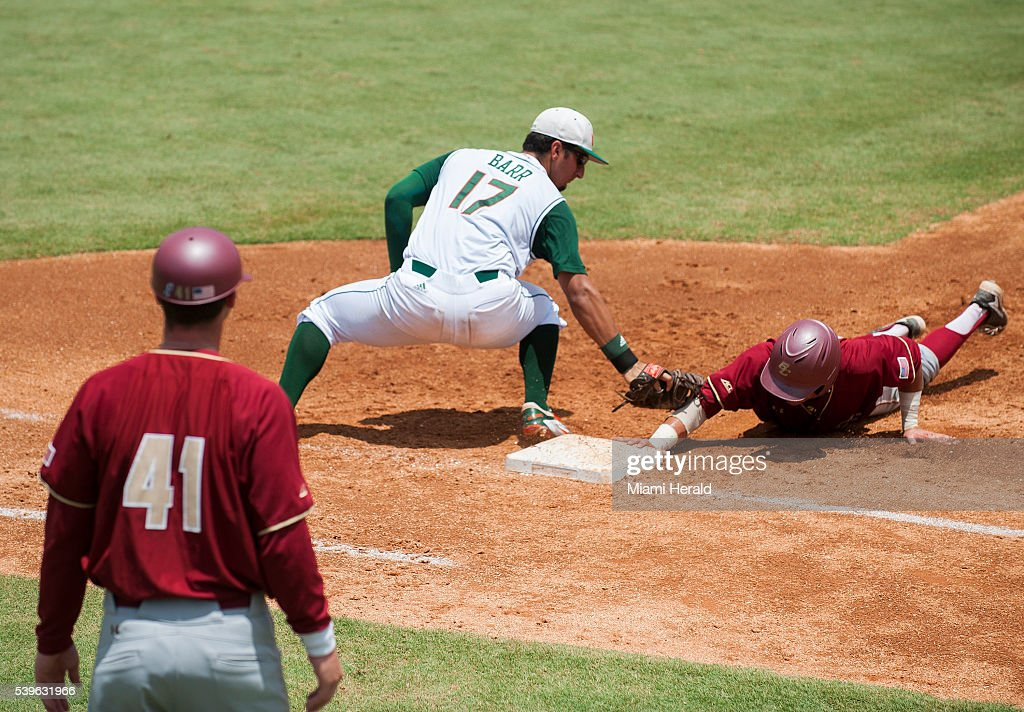 Miami Hurricanes first baseman Christopher Barr looks to tag out a Boston College runner during Game 3 of the NCAA Super Regionals on Sunday June 12...