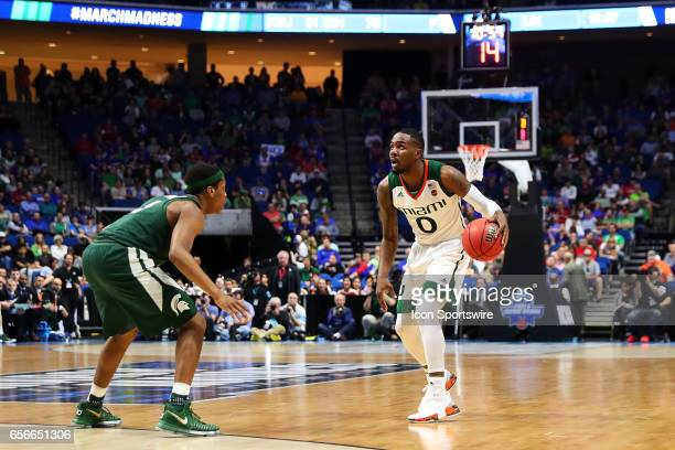Miami Hurricanes Guard Ja'Quan Newton checks the clock during the NCAA Division I Men's Basketball Championship first round game between the Michigan...