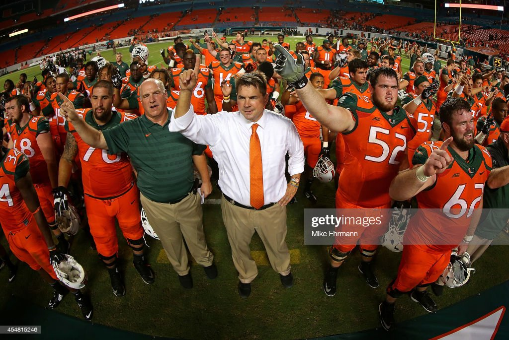 Miami Hurricanes head coach <a gi-track='captionPersonalityLinkClicked' href=/galleries/search?phrase=Al+Golden&family=editorial&specificpeople=6315572 ng-click='$event.stopPropagation()'>Al Golden</a> cheers with the team after a game against the Florida A&M Rattlers at Sunlife Stadium on September 6, 2014 in Miami, Florida.