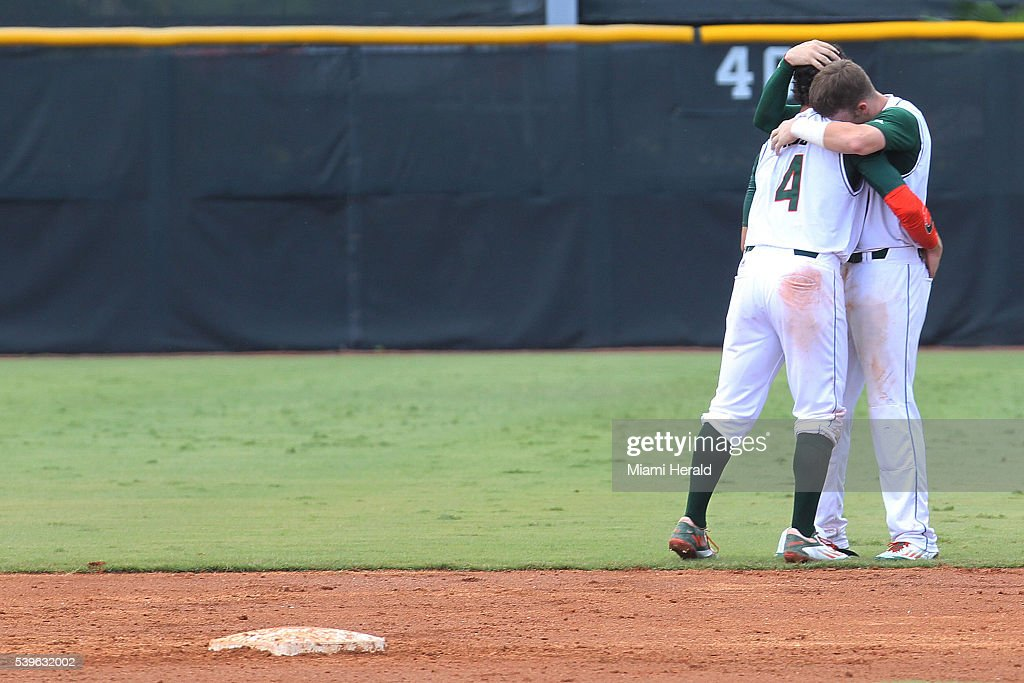 Miami Hurricanes infielder John Ruiz hugs his teammate after their team defeated Boston College 94 in Game 3 of the NCAA Super Regionals on Sunday...