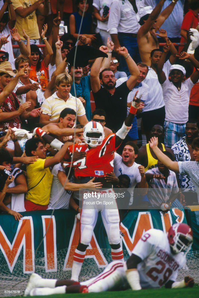 Miami Hurricanes' Michael Irvin joins the crowd in celebration after scoring a touchdown
